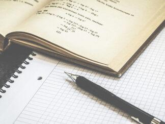 pen on math sentence book