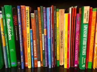 bookshelf of spanish textbooks
