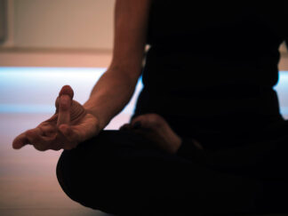 woman sitting in meditation position